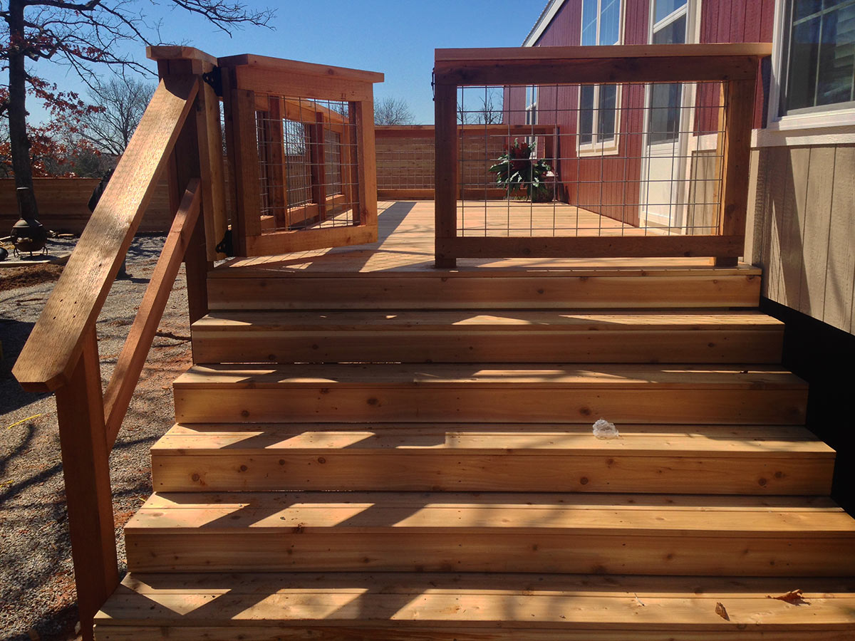 Large Raised Deck With Railing Gate And Steps In
