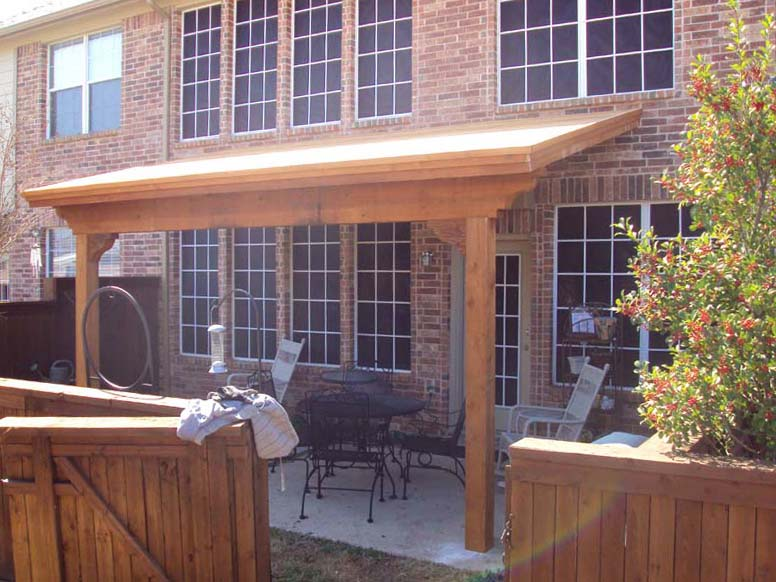 Slanted Patio Cover Attached To Brick Hundt Covers And Decks