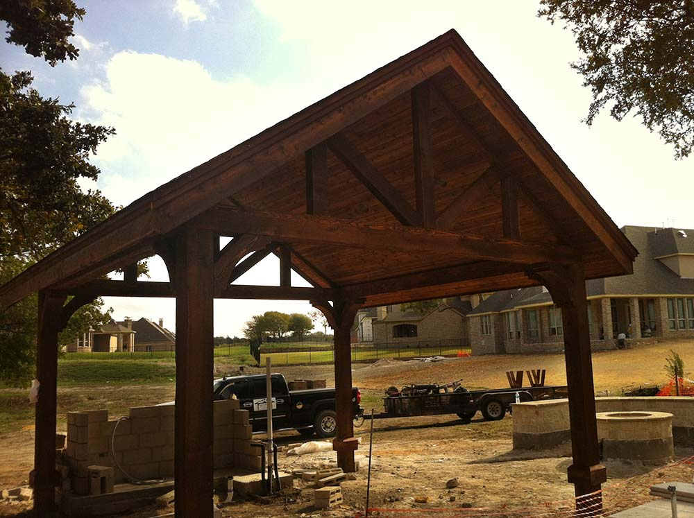 Large free standing patio cover with large beams in for Build a freestanding patio cover