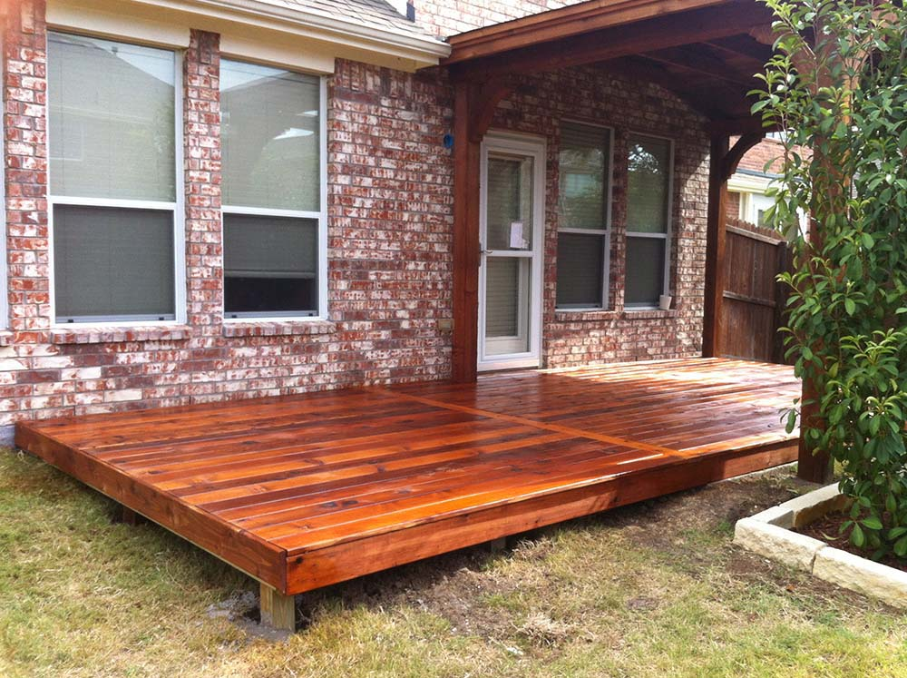 Shingled Patio Cover With Deck Extending Beyond Patio